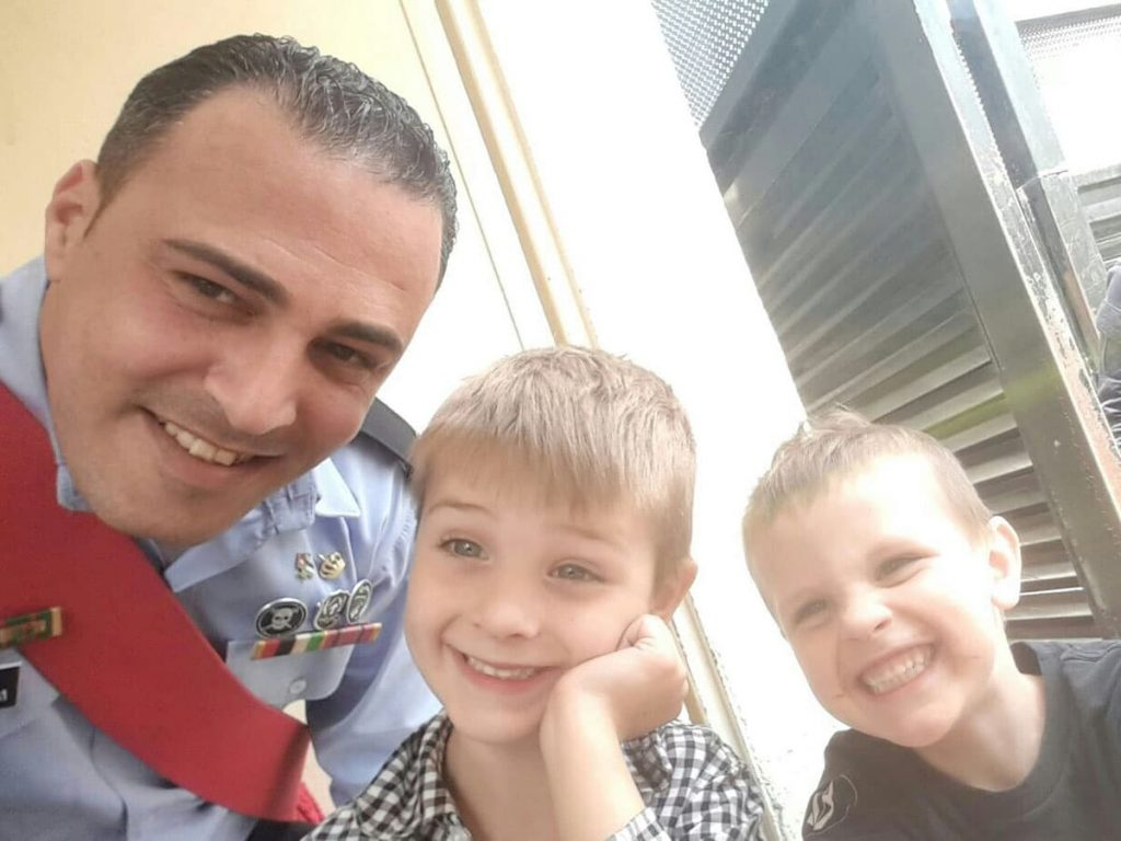 Police officer in Amman with kids.